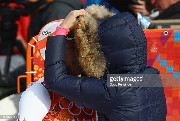 Morgan Miller comforts her husband Bode Miller of the United States during the Alpine Skiing Men's SuperG on day 9 of the Sochi 2014 Winter Olympics...