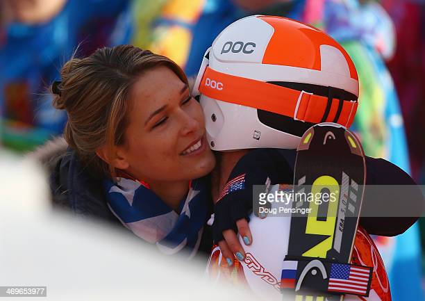 Morgan Miller greets her husband Bode Miller of the United States at the finish during the Alpine Skiing Men's SuperG on day 9 of the Sochi 2014...