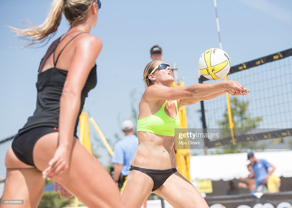 Morgan Miller (R) sets the ball for Jess Gysin (L) at the 2014 AVP Cincinnati Open on August 29, 2014 at the Lindner Family Tennis Center in Cincinnati, Ohio.