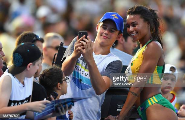 Morgan Mitchell of Australia poses for selfies with fans after competing in the Medley Relay during Nitro Athletics at Lakeside Stadium on February 4...