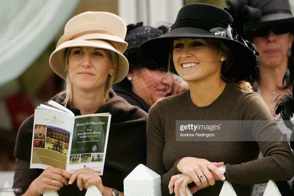 Morgan Norman (R), daughter of golfer Greg Norman and girlfriend of Sergio Garcia, and Emma Lofgren, girlfriend of Henrik Stenson (left) smile during the Ryder Cup Wives Race Day at The Curragh racecourse on September 19, 2006 in Naas, Ireland.