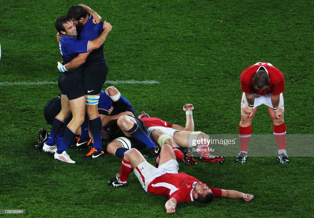 Morgan Parra and Lionel Nallet of France celebrate victory after the semi final one of the 2011 IRB Rugby World Cup between Wales and France at Eden Park on October 15, 2011 in Auckland, New Zealand.
