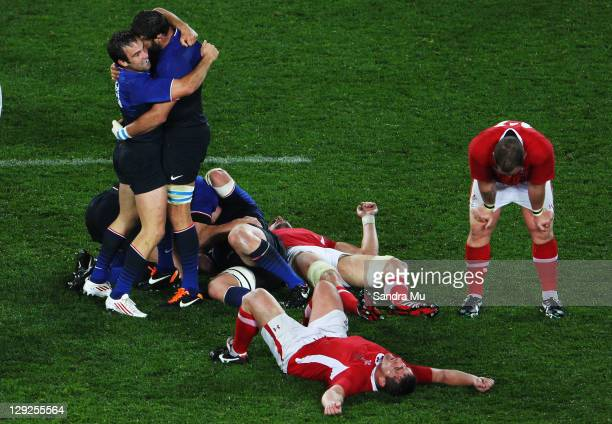 Morgan Parra and Lionel Nallet of France celebrate victory after the semi final one of the 2011 IRB Rugby World Cup between Wales and France at Eden...