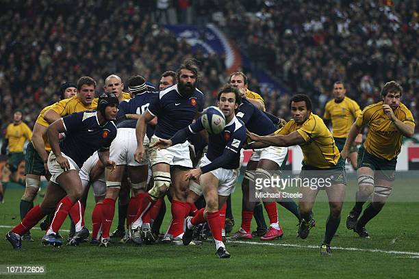 Morgan Parra of France feeds a pass as Will Genia of Australia looks on during the Test match between France and the Australian Wallabies at the...