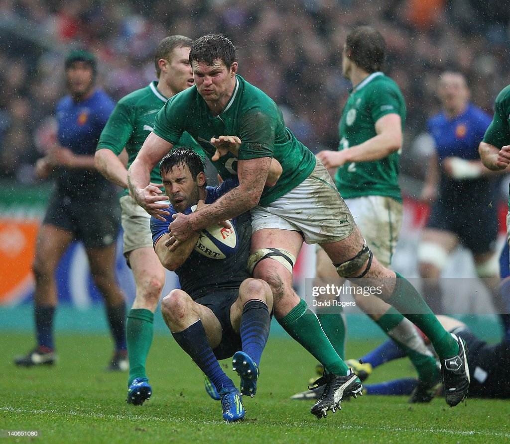 Morgan Parra of France is challenged by Donnacha Ryan during the RBS Six Nations match between France and Ireland at Stade de France on March 4, 2012 in Paris, France.