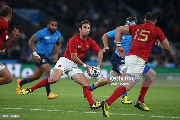 Morgan Parra of France looks to release Scott Spedding of France during the 2015 Rugby World Cup Pool D match between France and Italy at Twickenham...