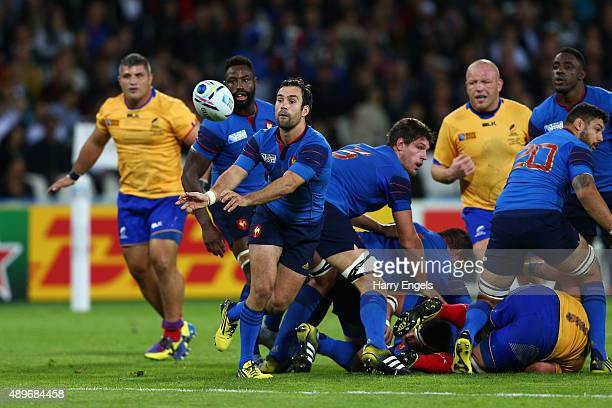 Morgan Parra of France passes during the 2015 Rugby World Cup Pool D match between France and Romania at the Olympic Stadium on September 23 2015 in...