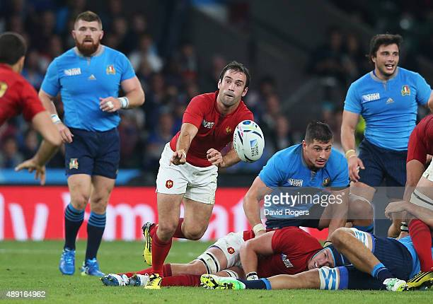Morgan Parra of France passes from the ruck during the 2015 Rugby World Cup Pool D match between France and Italy at Twickenham Stadium on September...