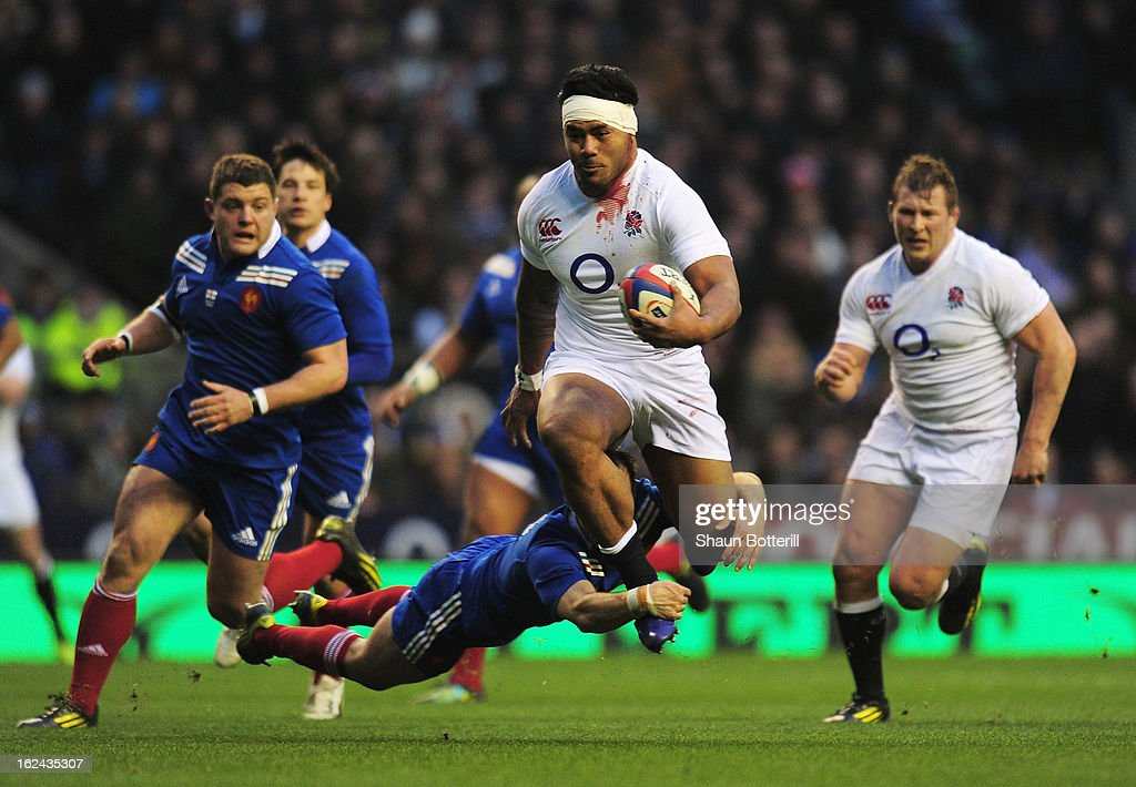 Morgan Parra of France tackles Manu Tuilagi of England during the RBS Six Nations match between England and France at Twickenham Stadium on February 23, 2013 in London, England.