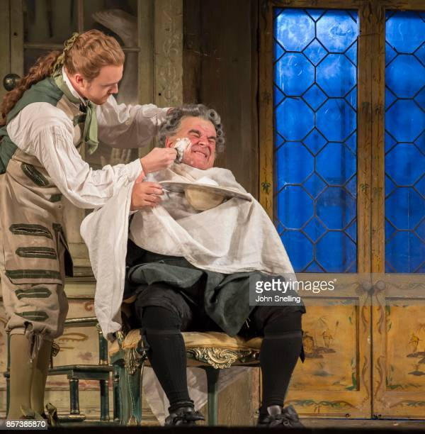 Morgan Pearse as Figaro and Alan Opie as Bartolo performs on stage in Jonathan Millers classic production of 'The Barber of Seville' at London...