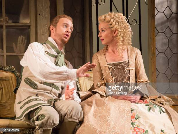 Morgan Pearse as Figaro and Sarah Tynan as Rosina perform on stage during a performance of Jonathan Millers classic production of 'The Barber of...