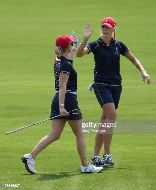 Morgan Pressel and Jessica Korda of the United States celebrate on the 16th fairway as they defeated Azahara Munoz of Spain and Karine Icher of...