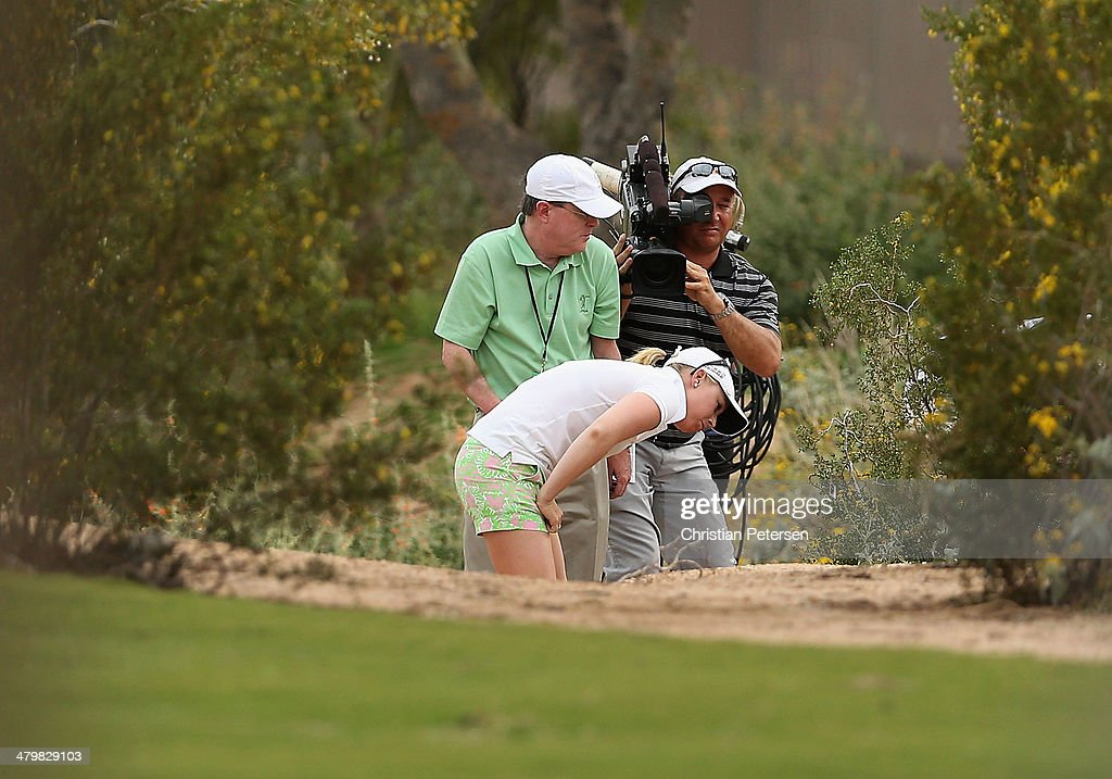 Morgan Pressel looks at her ball with an official on the third hole during the first round of the JTBC LPGA Founders Cup at Wildfire Golf Club on March 20, 2014 in Phoenix, Arizona.