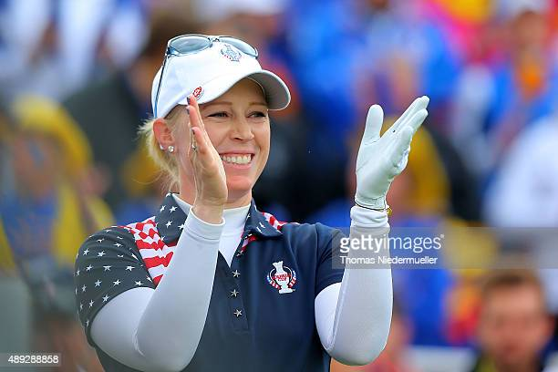 Morgan Pressel of the United States Team claps her hands at the first tee during the Sundays single matches in the 2015 Solheim Cup at St LeonRot...
