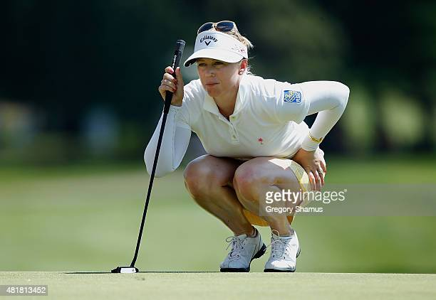 Morgan Pressel reads a putt on the 17th green during the second round of the Meijer LPGA Classic presented by Kraft at Blythefield Country Club on...