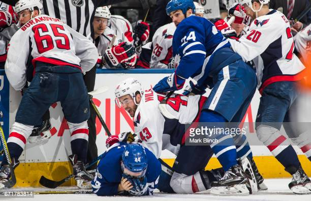 Morgan Rielly and Brian Boyle of the Toronto Maple Leafs battles with Tom Wilson Lars Eller and Andre Burakovsky of the Washington Capitals during...