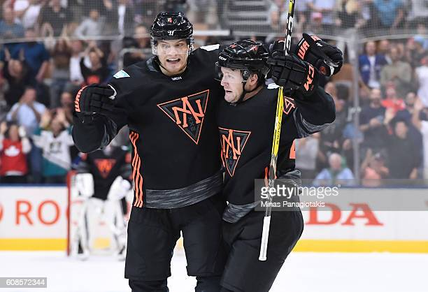 Morgan Rielly celebrates with Colton Parayko of Team North America after scoring a second period goal on Team Russia during the World Cup of Hockey...