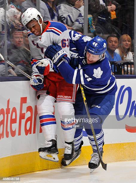 Morgan Rielly of the Toronto Maple Leafs battles with Anthony Duclair of the New York Rangers during NHL game action November 8 2014 at the Air...