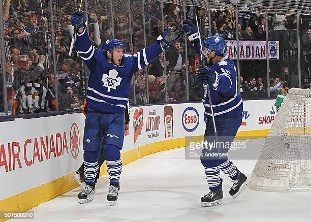 Morgan Rielly of the Toronto Maple Leafs celebrates a goal against the Tampa Bay Lightning during an NHL game at the Air Canada Centre on December 15...