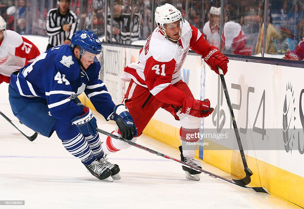 <a gi-track='captionPersonalityLinkClicked' href=/galleries/search?phrase=Morgan+Rielly&family=editorial&specificpeople=8050727 ng-click='$event.stopPropagation()'>Morgan Rielly</a> #44 of the Toronto Maple Leafs chases Luke Glendening #41 of the Detroit Red Wings during NHL Preseason action at the Air Canada Centre September 28, 2013 in Toronto, Ontario, Canada.