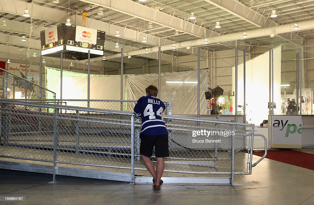 Morgan Rielly of the Toronto Maple Leafs chats on the phone during the media opportunity at the 2012 NHLPA rookie showcase at the MasterCard Centre on August 28, 2012 in Toronto, Canada.