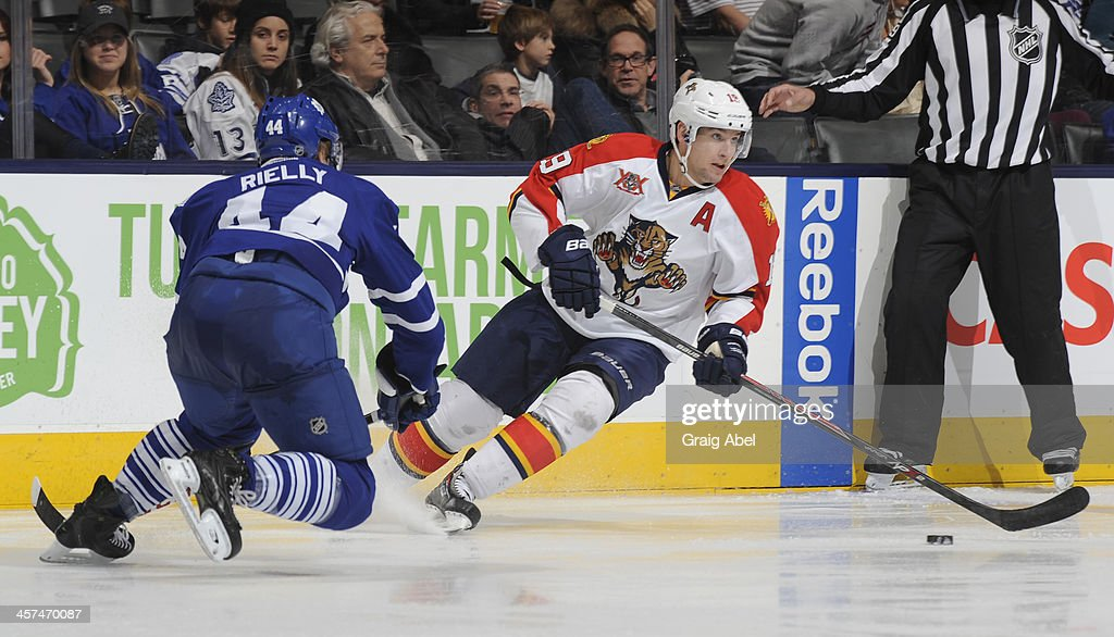 <a gi-track='captionPersonalityLinkClicked' href=/galleries/search?phrase=Morgan+Rielly&family=editorial&specificpeople=8050727 ng-click='$event.stopPropagation()'>Morgan Rielly</a> #44 of the Toronto Maple Leafs defends as <a gi-track='captionPersonalityLinkClicked' href=/galleries/search?phrase=Scottie+Upshall&family=editorial&specificpeople=209198 ng-click='$event.stopPropagation()'>Scottie Upshall</a> #19 of the Florida Panthers looks to pass the puck during NHL game action December 17, 2013 at the Air Canada Centre in Toronto, Ontario, Canada.