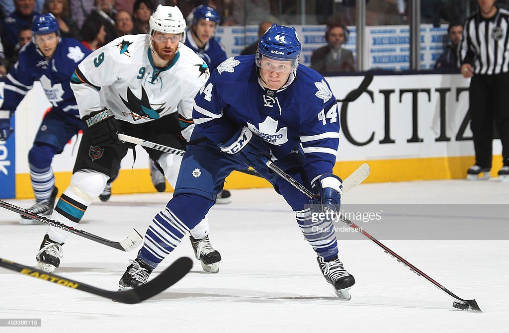 <a gi-track='captionPersonalityLinkClicked' href=/galleries/search?phrase=Morgan+Rielly&family=editorial&specificpeople=8050727 ng-click='$event.stopPropagation()'>Morgan Rielly</a> #44 of the Toronto Maple Leafs moves in for a shot against the San Jose Sharks during an NHL game at the Air Canada Centre on December 3, 2013 in Toronto, Ontario, Canada. The Sharks defeated the Leafs 4-2.