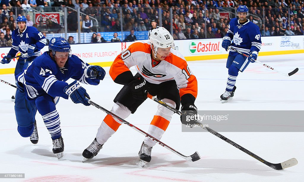 <a gi-track='captionPersonalityLinkClicked' href=/galleries/search?phrase=Morgan+Rielly&family=editorial&specificpeople=8050727 ng-click='$event.stopPropagation()'>Morgan Rielly</a> #44 of the Toronto Maple Leafs pokes the puck from <a gi-track='captionPersonalityLinkClicked' href=/galleries/search?phrase=Brayden+Schenn&family=editorial&specificpeople=4782304 ng-click='$event.stopPropagation()'>Brayden Schenn</a> #10 of the Philadelphia Flyers during NHL action at the Air Canada Centre March 8, 2014 in Toronto, Ontario, Canada.