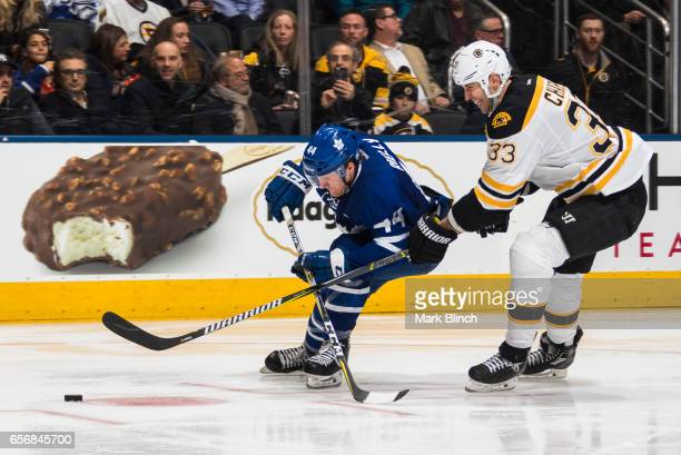 Morgan Rielly of the Toronto Maple Leafs skates against Zdeno Chara of the Boston Bruins during the third period at the Air Canada Centre on March 20...