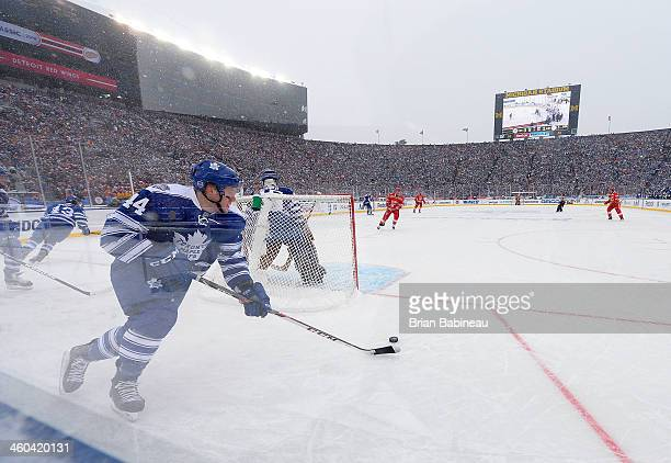 Morgan Rielly of the Toronto Maple Leafs skates the puck around the net in the second period during the 2014 Bridgestone NHL Winter Classic on...