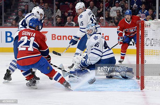 Morgan Rielly Paul Ranger and Jonathan Bernier of the Toronto Maple Leafs defend the net against Brian Gionta and Daniel Briere of the Montreal...
