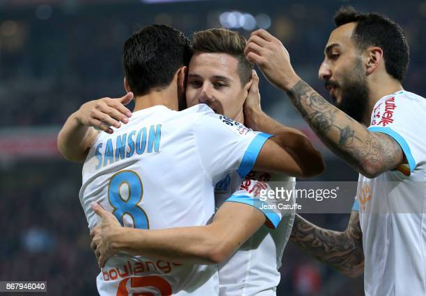 Morgan Sanson of OM celebrates his goal with Florian Thauvin Konstantinos Kostas Mitroglou during the French Ligue 1 match between Lille OSC and...