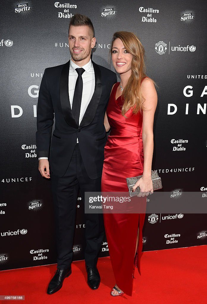 Morgan Schneiderlin and Camile Sold attend the United for UNICEF Gala Dinner at Old Trafford on November 29, 2015 in Manchester, England.