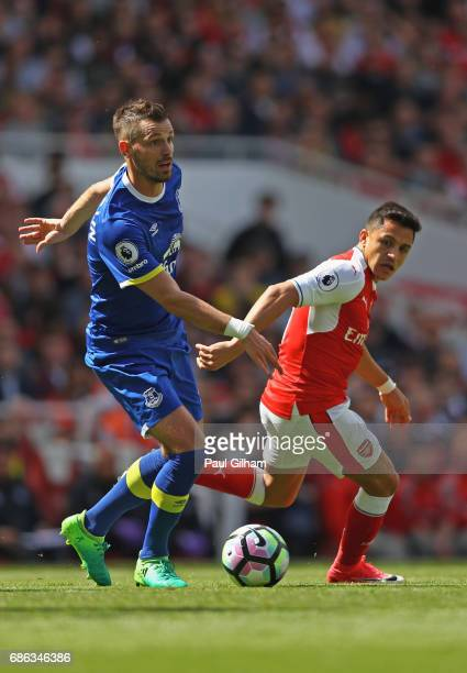 Morgan Schneiderlin of Everton and Alexis Sanchez of Arsenal in action during the Premier League match between Arsenal and Everton at Emirates...