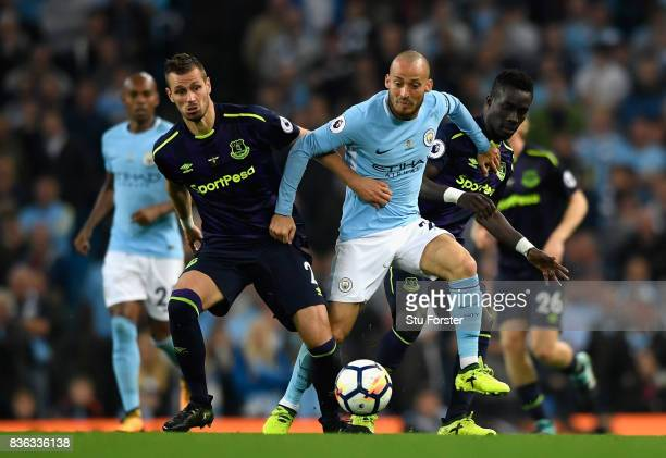 Morgan Schneiderlin of Everton and David Silva of Manchester City battle for possession during the Premier League match between Manchester City and...