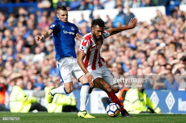 Morgan Schneiderlin of Everton and Eric Maxim ChoupoMoting of Stoke City during the Premier League match between Everton and Stoke City at Goodison...
