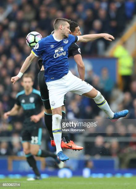 Morgan Schneiderlin of Everton and Jake Livermore of West Bromwich Albion battle to win a header during the Premier League match between Everton and...