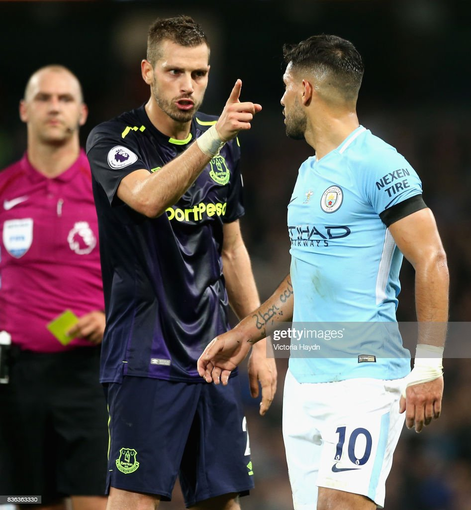 Morgan Schneiderlin of Everton and Sergio Aguero of Manchester City square up after Morgan Schneiderlin of Everton is shown a red card during the Premier League match between Manchester City and Everton at Etihad Stadium on August 21, 2017 in Manchester, England.