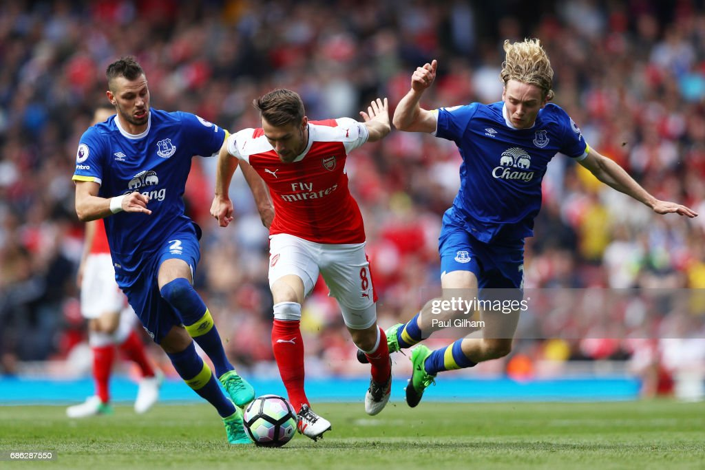 Morgan Schneiderlin of Everton and Tom Davies of Everton attempt to tackle Aaron Ramsey of Arsenal during the Premier League match between Arsenal and Everton at Emirates Stadium on May 21, 2017 in London, England.