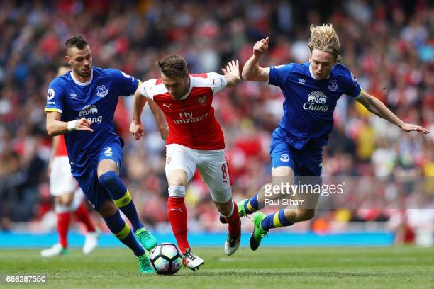 Morgan Schneiderlin of Everton and Tom Davies of Everton attempt to tackle Aaron Ramsey of Arsenal during the Premier League match between Arsenal...