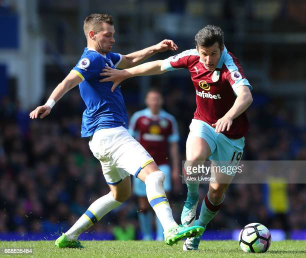 Morgan Schneiderlin of Everton attempts to tackle Joey Barton of Burnley during the Premier League match between Everton and Burnley at Goodison Park...