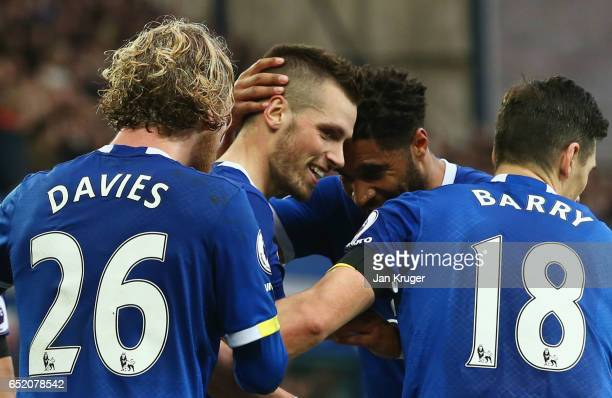 Morgan Schneiderlin of Everton celebrates scoring his sides second goal with his Everton team mates during the Premier League match between Everton...