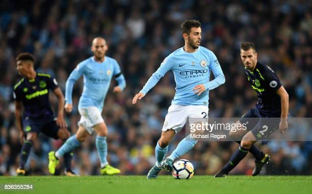 Morgan Schneiderlin of Everton closes down Bernardo Silva of Manchester City during the Premier League match between Manchester City and Everton at...