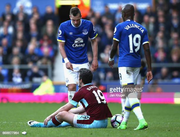 Morgan Schneiderlin of Everton exchanges words with Joey Barton of Burnley after a challenge during the Premier League match between Everton and...
