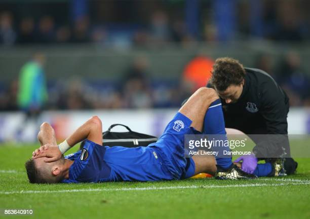 Morgan Schneiderlin of Everton FC lies injured during the UEFA Europa League group E match between Everton FC and Olympique Lyon at Goodison Park on...