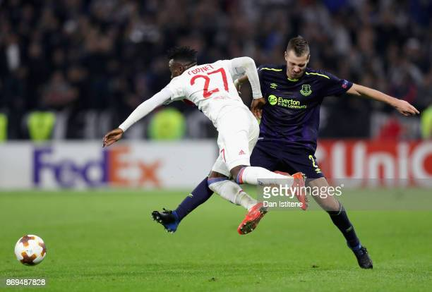 Morgan Schneiderlin of Everton fouls Maxwel Cornet of Lyon and is later awarded his second yellow of the game which led to his sending off during the...