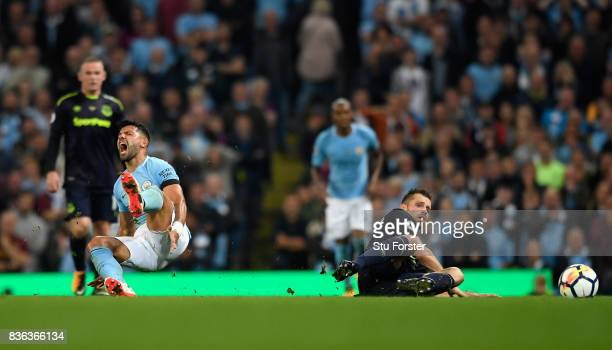 Morgan Schneiderlin of Everton fouls Sergio Aguero of Manchester City prior to being shown a second yellow card during the Premier League match...