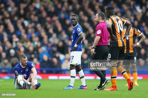 Morgan Schneiderlin of Everton is injured during the Premier League match between Everton and Hull City at Goodison Park on March 18 2017 in...