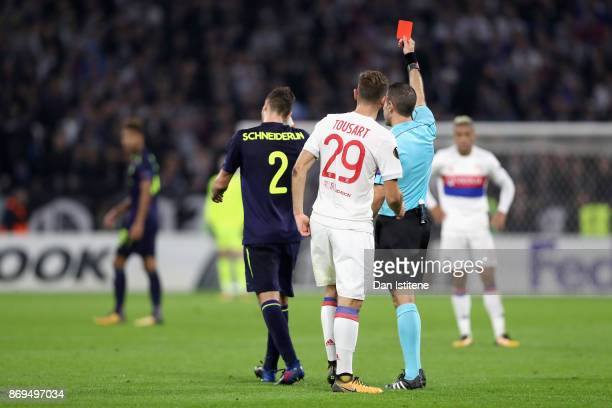 Morgan Schneiderlin of Everton is shown a red card by referee Orel Grinfeld during the UEFA Europa League group E match between Olympique Lyon and...
