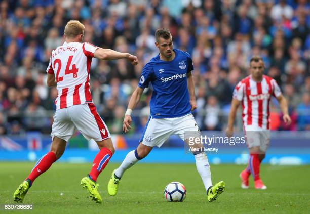 Morgan Schneiderlin of Everton is tackled by Darren Fletcher of Stoke City during the Premier League match between Everton and Stoke City at Goodison...